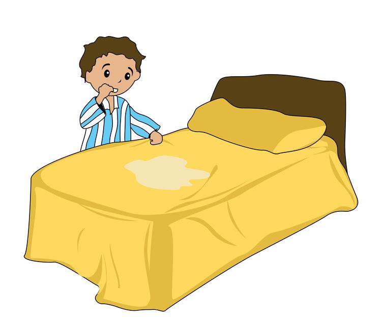 Fortvilet gutt står forann sin våte seng. Han er sengevæter.
