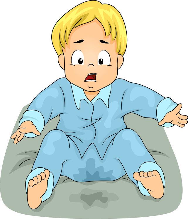 Fortvilet sittende gutt i tissevåt pysjamas - plaget av sengevæting